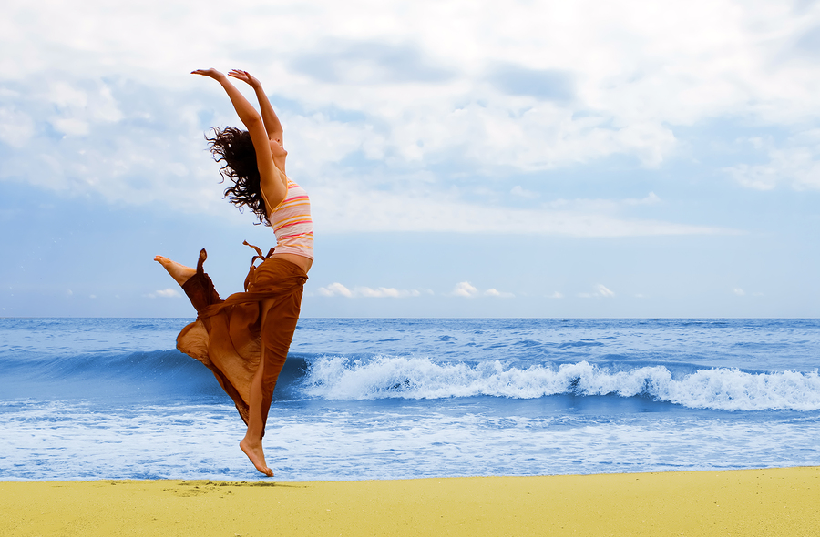 bigstock-happy-young-woman-is-jumping-i-17607320